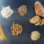 pasta, wheat, flour, grains and sliced bread on a table