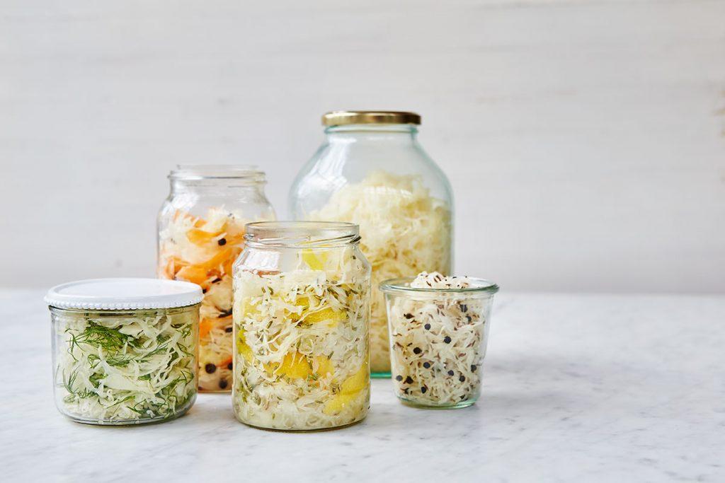 fermenting - vegetables filled into jars