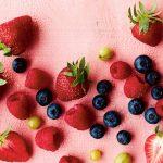 seasonal fruit flat lay of berries and water droplets