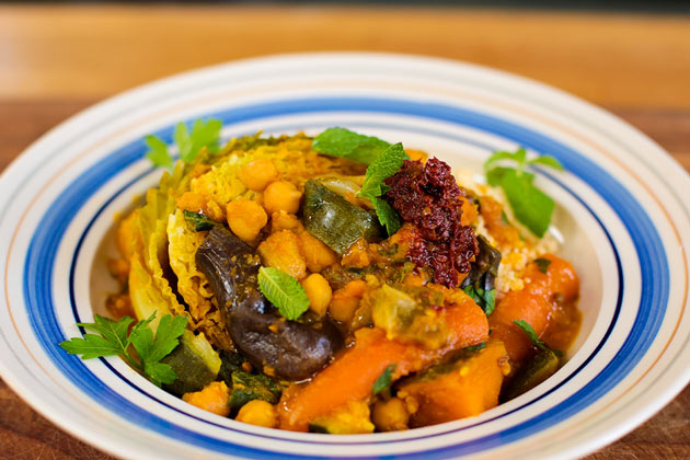 7 veg tagine with herbs on top in a bowl