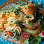 Mexican recipes - flatbread with hot sauce, cheese, tomatoes and herbs