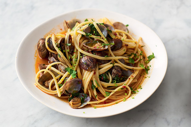 vongole dish, spaghetti with seafood clams and herbs on top