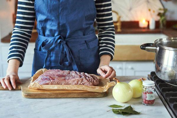 Salt beef on chopping board