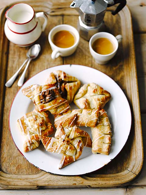 Danish pastries on a tray with coffee