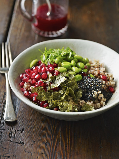 brown rice bowl with edemame beans, seaweed and pomegranate