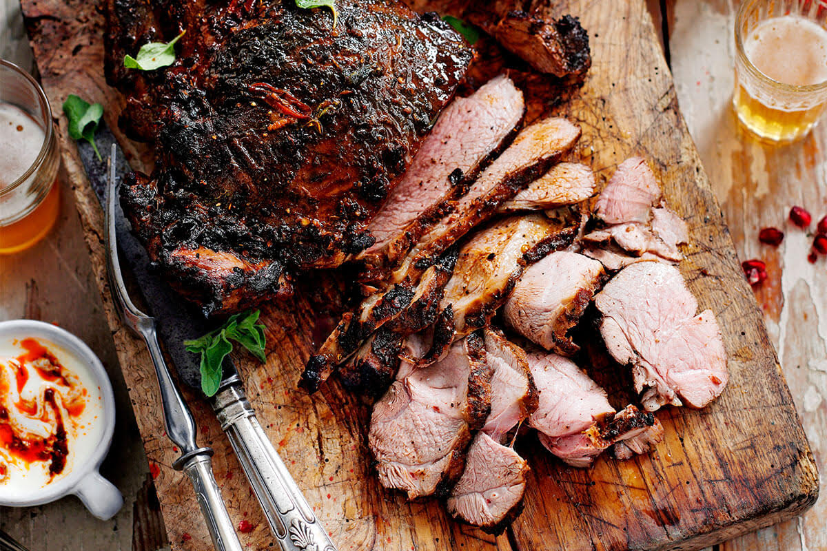 Image of cooked, butterflied lamb on a chopping board