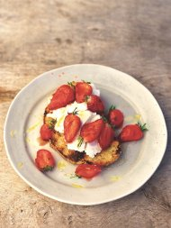 Charred eggy bread with strawberries and honey
