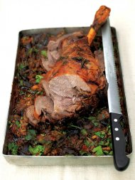 Roast leg of lamb with aubergines and onions