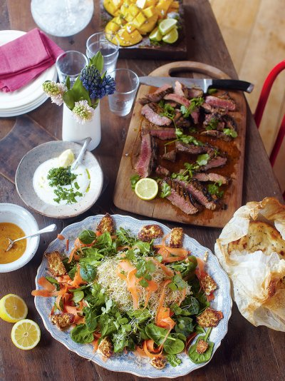 Steak Indian-style, spinach & paneer salad, naan breads, mango dessert