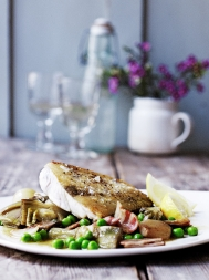 Hake with braised artichokes, peas & bacon