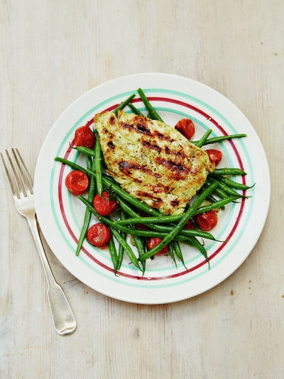 Tasty grilled chicken with warm green bean salad