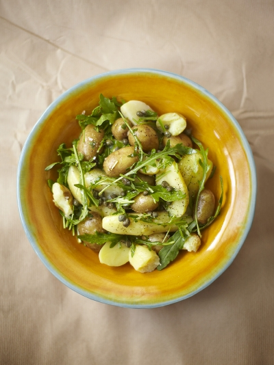Warm potato salad with capers and rocket